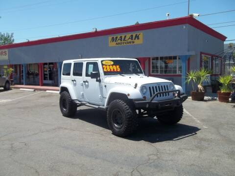 2012 Jeep Wrangler Unlimited for sale at Atayas Motors INC #1 in Sacramento CA