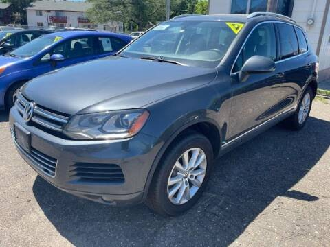 2014 Volkswagen Touareg for sale at CHRISTIAN AUTO SALES in Anoka MN