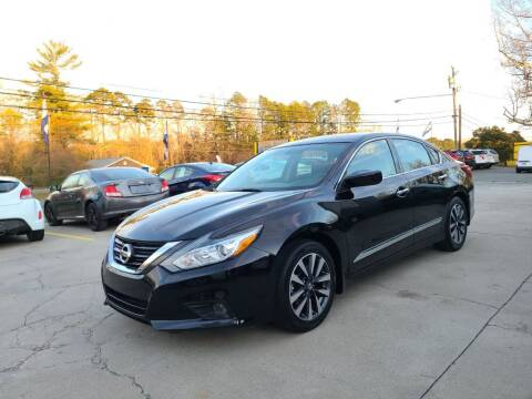 2016 Nissan Altima for sale at DADA AUTO INC in Monroe NC