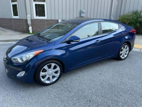 2013 Hyundai Elantra for sale at AMERICAR INC in Laurel MD