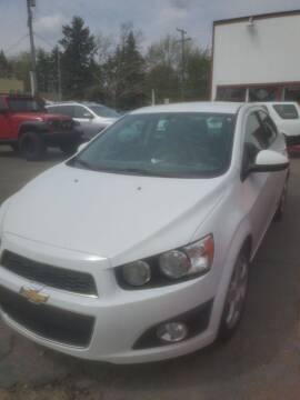 2014 Chevrolet Sonic for sale at J & J Used Cars inc in Wayne MI
