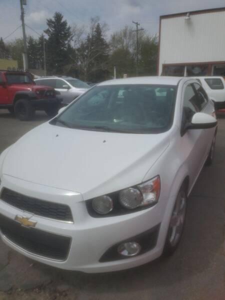 2014 Chevrolet Sonic for sale at J & J Used Cars inc in Wayne MI