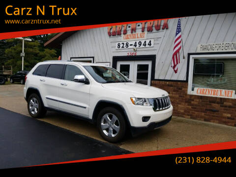 2011 Jeep Grand Cherokee for sale at Carz N Trux in Twin Lake MI