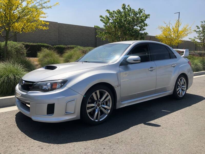 2011 Subaru Impreza for sale at Carmelo Auto Sales Inc in Orange CA