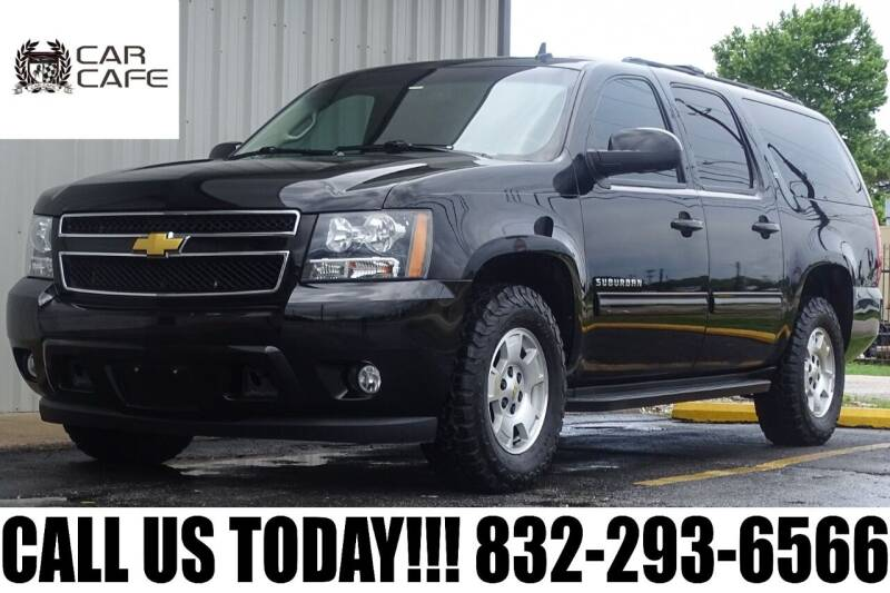 2014 Chevrolet Suburban for sale at CAR CAFE LLC in Houston TX