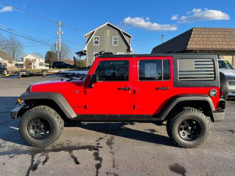 2016 Jeep Wrangler Unlimited for sale at MAGNUM MOTORS in Reedsville PA