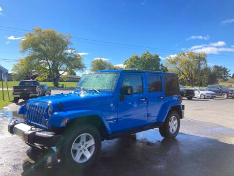 2011 Jeep Wrangler Unlimited for sale at Deals on Wheels Auto Sales in Scottville MI