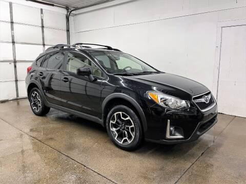 2016 Subaru Crosstrek for sale at PARKWAY AUTO in Hudsonville MI