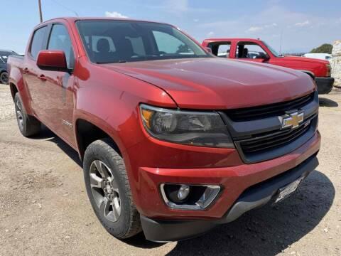 2016 Chevrolet Colorado for sale at BERKENKOTTER MOTORS in Brighton CO