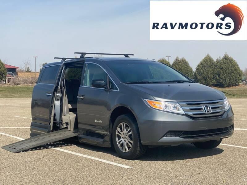 2011 Honda Odyssey for sale at RAVMOTORS in Burnsville MN