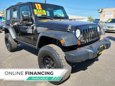 2012 Jeep Wrangler Unlimited for sale at Super Cars Sales Inc #1 in Oakdale CA