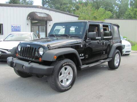2009 Jeep Wrangler Unlimited for sale at Pure 1 Auto in New Bern NC