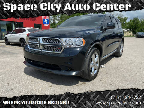 2013 Dodge Durango for sale at Space City Auto Center in Houston TX