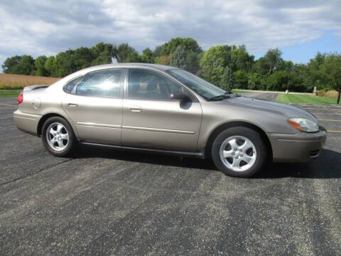 2005 Ford Taurus for sale at Crossroads Used Cars Inc. in Tremont IL