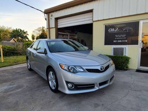 2012 Toyota Camry for sale at O & J Auto Sales in Royal Palm Beach FL