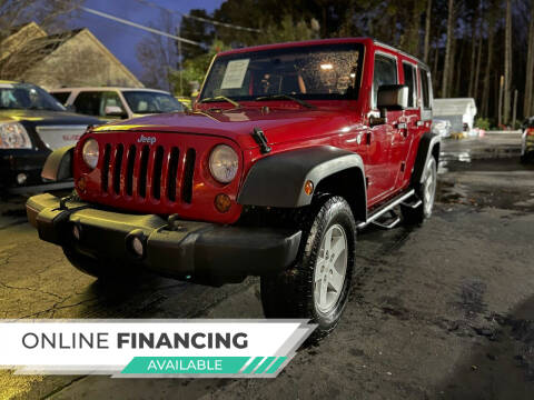 2011 Jeep Wrangler Unlimited for sale at Magic Motors Inc. in Snellville GA