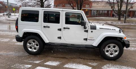 2013 Jeep Wrangler Unlimited for sale at Mulder Auto Tire and Lube in Orange City IA