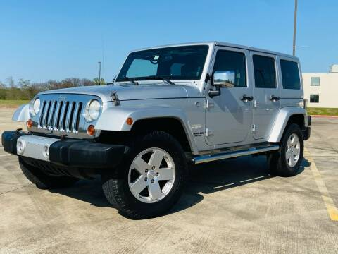 2011 Jeep Wrangler Unlimited for sale at AUTO DIRECT Bellaire in Houston TX