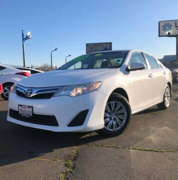 2014 Toyota Camry for sale at LUGO AUTO GROUP in Sacramento CA