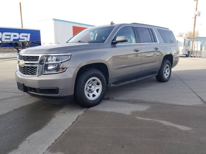2018 Chevrolet Suburban for sale at KHAN'S AUTO LLC in Worland WY