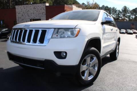 2011 Jeep Grand Cherokee for sale at Atlanta Unique Auto Sales in Norcross GA