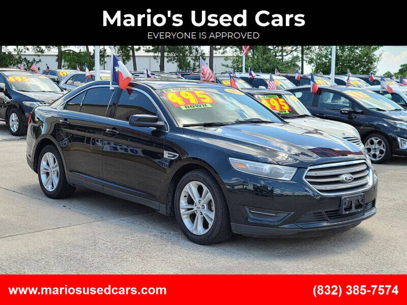 2014 Ford Taurus for sale at Mario's Used Cars in Houston TX
