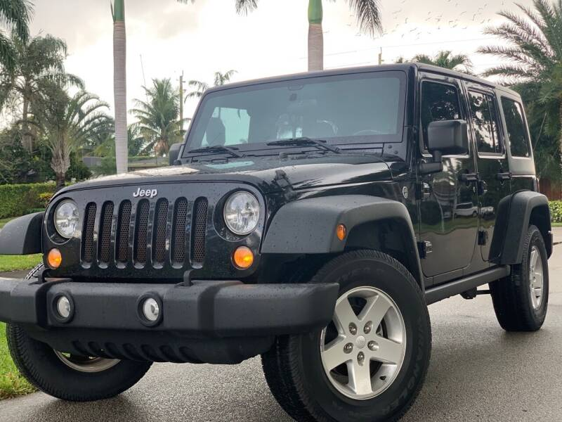 2016 Jeep Wrangler Unlimited for sale at HIGH PERFORMANCE MOTORS in Hollywood FL