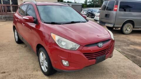 2013 Hyundai Tucson for sale at ZORA MOTORS in Rosenberg TX