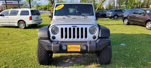 2012 Jeep Wrangler Unlimited for sale at Kinston Auto Mart in Kinston NC