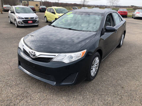 2012 Toyota Camry for sale at Carmans Used Cars & Trucks in Jackson OH
