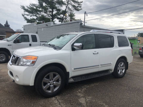 2011 Nissan Armada for sale at Jim's Hometown Auto Sales LLC in Byesville OH