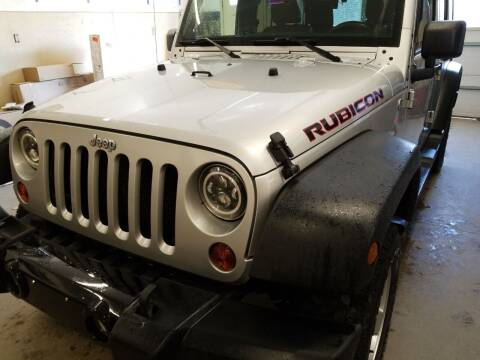 2011 Jeep Wrangler Unlimited for sale at MARVIN'S AUTO BODY in Farmington ME