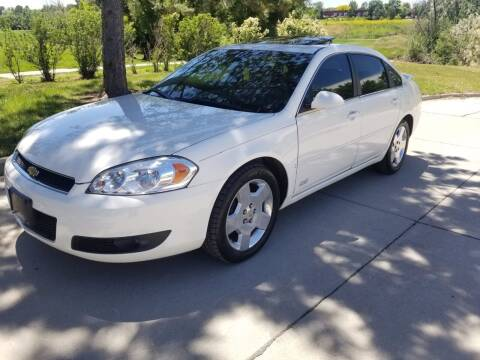 2007 Chevrolet Impala for sale at QUEST MOTORS in Englewood CO