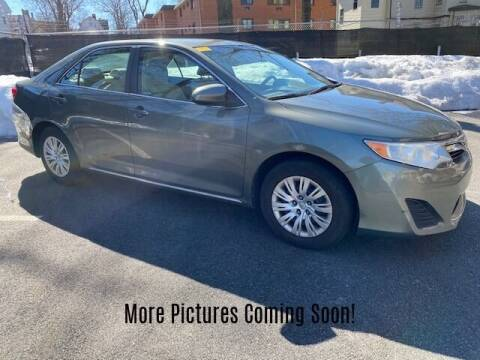 2014 Toyota Camry for sale at Warner Motors in East Orange NJ