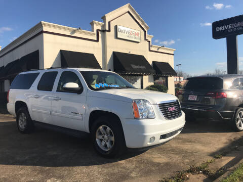 2011 GMC Yukon XL for sale at DRIVE ZONE AUTOS in Montgomery AL