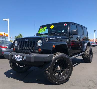 2012 Jeep Wrangler Unlimited for sale at LUGO AUTO GROUP in Sacramento CA