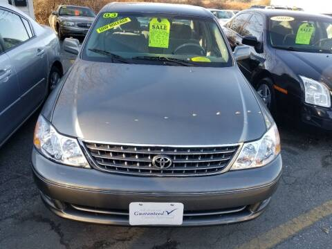 2003 Toyota Avalon for sale at Howe's Auto Sales in Lowell MA