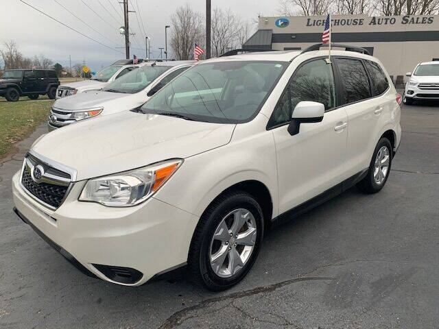 2014 Subaru Forester for sale at Lighthouse Auto Sales in Holland MI