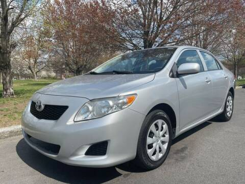 2010 Toyota Corolla for sale at NEW ENGLAND AUTO MALL in Lowell MA