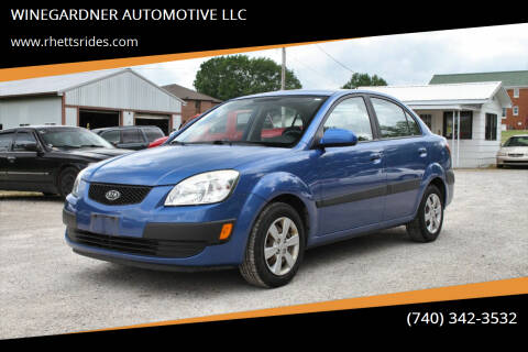 2009 Kia Rio for sale at WINEGARDNER AUTOMOTIVE LLC in New Lexington OH