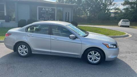 2009 Honda Accord for sale at AMG Automotive Group in Cumming GA