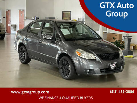 2011 Suzuki SX4 for sale at GTX Auto Group in West Chester OH