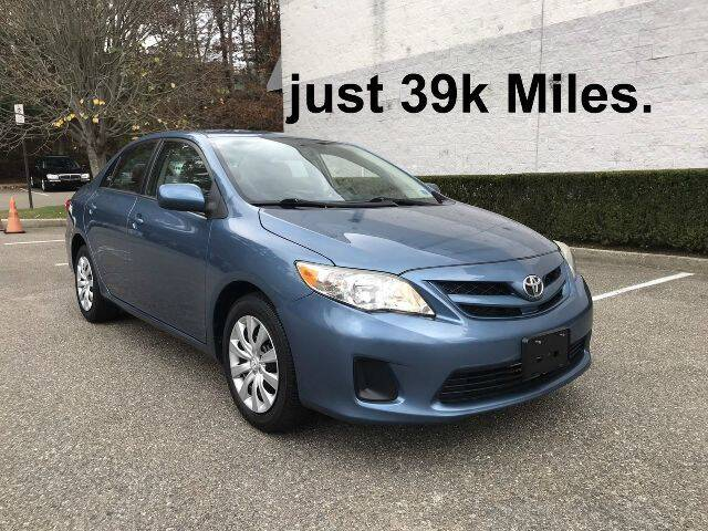 2012 Toyota Corolla for sale at Select Auto in Smithtown NY