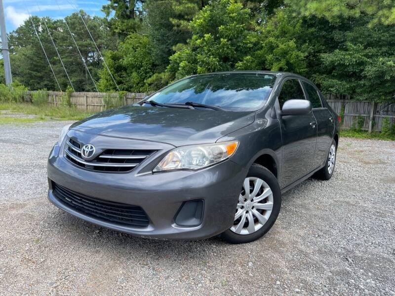 2013 Toyota Corolla for sale at Glamorous Motors in Woodstock GA
