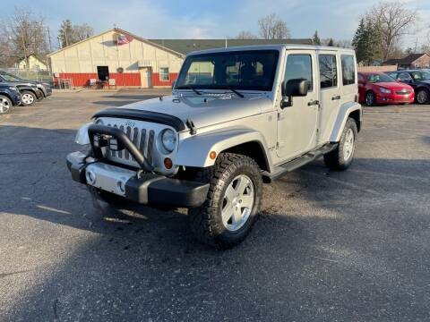2012 Jeep Wrangler Unlimited for sale at Dean's Auto Sales in Flint MI