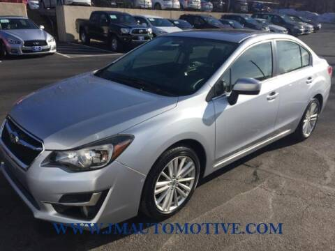 2015 Subaru Impreza for sale at J & M Automotive in Naugatuck CT
