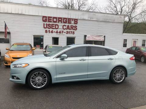2013 Ford Fusion Hybrid for sale at George's Used Cars Inc in Orbisonia PA