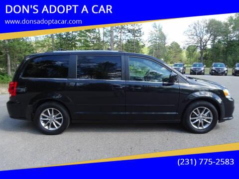 2015 Dodge Grand Caravan for sale at DON'S ADOPT A CAR in Cadillac MI