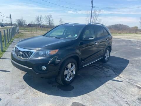 2012 Kia Sorento for sale at HEDGES USED CARS in Carleton MI