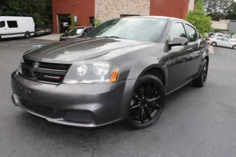 2014 Dodge Avenger for sale at Atlanta Unique Auto Sales in Norcross GA